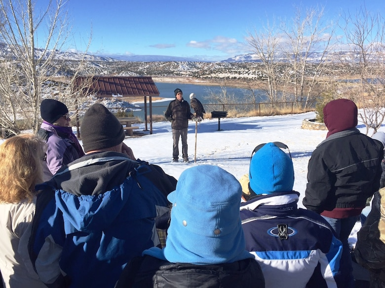 ABIQUIU LAKE, N.M. -- Scott Bol, volunteer with the New Mexico Wildlife Center, displays the center's captive non-releasable bald eagle to volunteers before they begin counting wild eagles around the lake, Jan. 9, 2016.