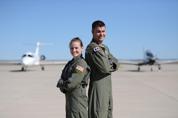 Maj. Regina Wall, 86th Flying Training Squadron assistant director of operations, and Maj. Jared Wall, 47th Operations Group T-6A Texan II standardization and evaluation branch chief, pose for a photo on Laughlin Air Force Base, Texas, Jan. 15, 2016. Although moving from base to base, deploying and working long and erratic hours for more than 10 years, the Walls and their two children have found a balance in the military and their personal lives. (U.S. Air Force photo by Airman 1st Class Brandon May)(U.S. Air Force photo by Airman 1st Class Brandon May)