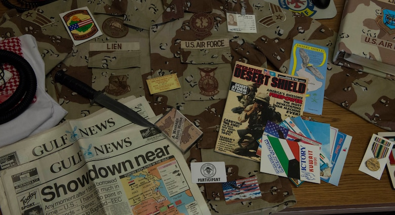 Desert Storm mementos cover the desk of Chief Master Sgt. Richard Lien, 366th Civil Engineer Squadron fire department chief, at Mountain Home Air Force Base, Idaho, Jan. 13, 2016. Lien provided fire protection services during his time in Desert Storm and continues to serve in that career field today. (U.S. Air Force photo by Airman Chester Mientkiewicz/RELEASED)