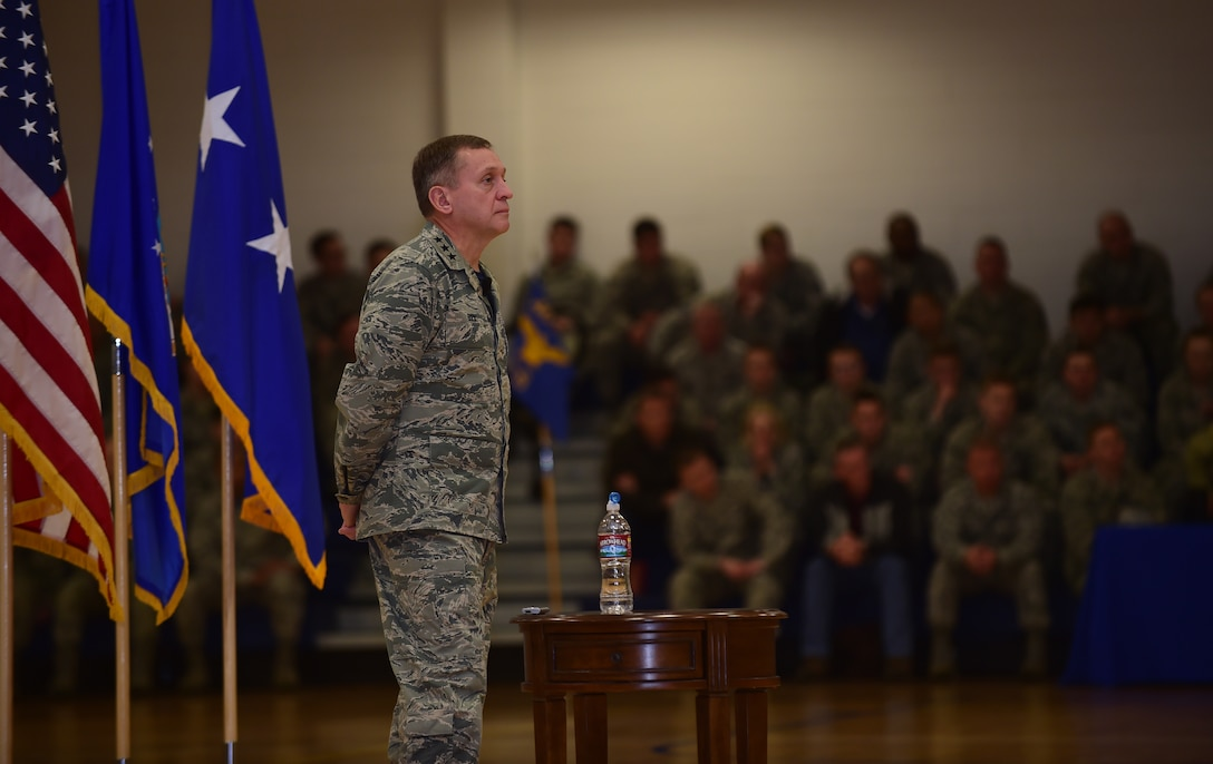 Lt. Gen. David J. Buck, Commander, 14th Air Force (Air Forces Strategic), Air Force Space Command; and Commander, Joint Functional Component Command for Space, U.S. Strategic Command, listens as Chief Master Sgt. Craig A. Neri, Command Chief Master Sergeant, 14th Air Force (Air Forces Strategic), Air Force Space Command; and Command Senior Enlisted Leader, Joint Functional Component Command for Space, U.S. Strategic Command, speaks during a commander's call Jan. 15, 2016, at Buckley Air Force Base, Colo. Buck visited base facilities and met with members of Team Buckley to discuss the 460th Space Wing mission. (U.S. Air Force photo by Airman 1st Class Gabrielle Spradling)