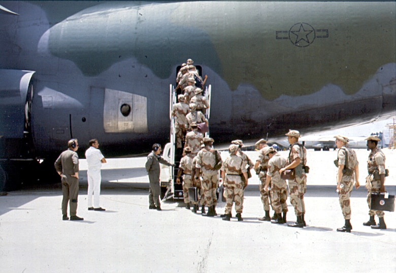 Members of the 5th Combat Communications Group board a U.S. Air Force C-5 Galaxy at an undisclosed location during Operation Desert Storm, 1991. The famed operation that was one of many during the First Gulf War which occurred from 2 August 1990 to 28 February 1991, will mark its 25th anniversary on 17 Jan 2016. (courtesy photo)