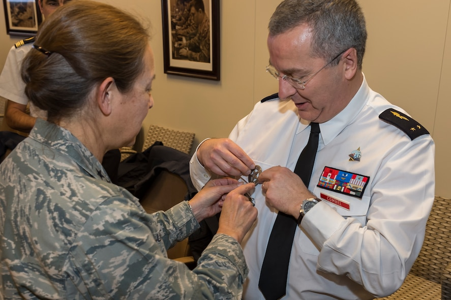 """U.S. Air Force Maj. Gen. Shelia Zuehlke (left), mobilization assistant to the commander, 24th Air Force and Air Forces Cyber Command (AFCYBER), presents French Air Force Brig. Gen. Thierry Combel, Deputy Director General of Employment and Training, Air Force Human Resources with a 24AF """"ranger badge"""" as a gift during his visit to Headquarters, 24AF - AFCYBER, Joint Base San Antonio - Lackland, Texas, Jan 13. Combel, along with other members of a cybersecurity delegation visited to discuss how the U.S. and French Air Force's approach cyber organization, training, and exercise participation as well as to facilitate future partnerships and engagements. (U.S. Air Force photo by Master Sgt. Luke P. Thelen/Released)"""