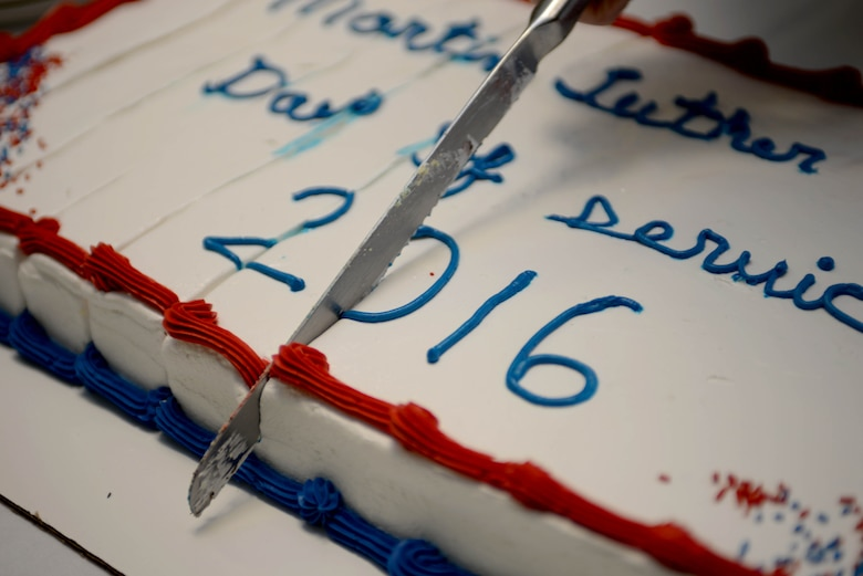 A cake cutting ceremony is performed for Martin Luther King, Jr. Day of Observance at Ellsworth Air Force Base, S.D., Jan. 12, 2016. The Diversity Council recognized the holiday to motivate Airmen to embrace diversity and community service. For more information about the council, call (605) 385-1342. (U.S. Air Force photo by Airman Sadie Colbert/Released)