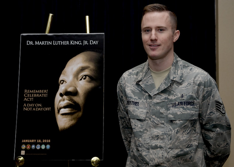 Staff Sgt. Erik Perthel, 28th Medical Operations Squadron public health technician, stands in front of the Martin Luther King, Jr. Day of Observance poster at Ellsworth Air Force Base, S.D., Jan. 12, 2016. Perthel spoke on the importance of MLK Jr. Day of Observance and diversity during a recognition event. (U.S. Air Force photo by Airman Sadie Colbert/Released)