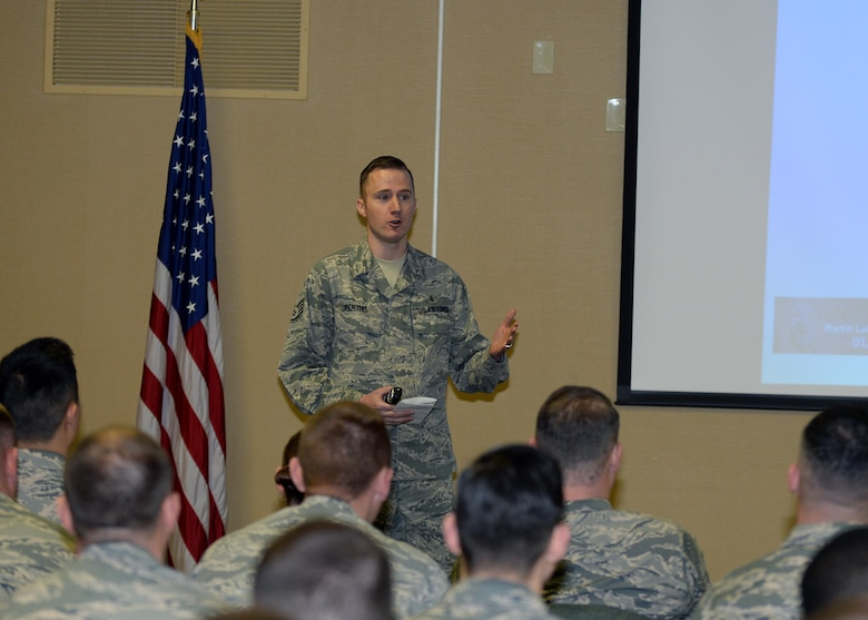 Staff Sgt. Erik Perthel, 28th Medical Operations Squadron public health technician, speaks about Martin Luther King, Jr. Day of Observance at Ellsworth Air Force Base, S.D., Jan. 12, 2016. Approximately 59 Airmen attended the briefing to learn the meaning behind the holiday. (U.S. Air Force photo by Airman Sadie Colbert/Released)