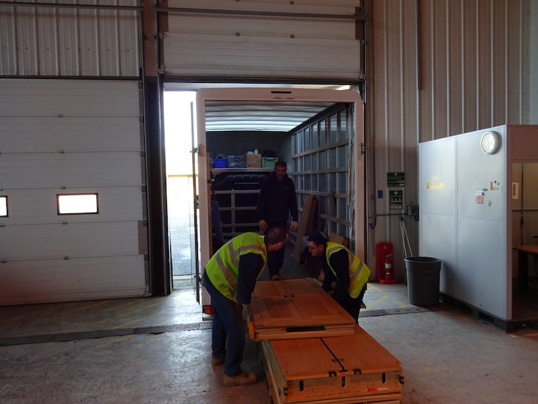 Workers from Arrowdene Moving & Storage in Thetford deliver new appliances at Royal Air Force Lakenheath, England, Jan. 13, 2016. Working with the local community is vital in accomplishing the mission of the 48th Fighter Wing. (Courtesy Photo)