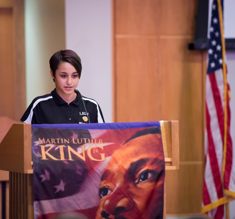 Jailee Britt, daughter of Master Sgt. Jamie Britt, 437th Operations Squadron Weather flight chief, recites a speech excerpt during a Martin Luther King Jr. Day Celebration event Jan. 15, 2016, at the Chapel Annex on Joint Base Charleston – Air Base, S.C. JB Charleston's Multicultural Committee put up the event in celebration of King's legacy. (U.S. Air Force Photo/Senior Airman Clayton Cupit)
