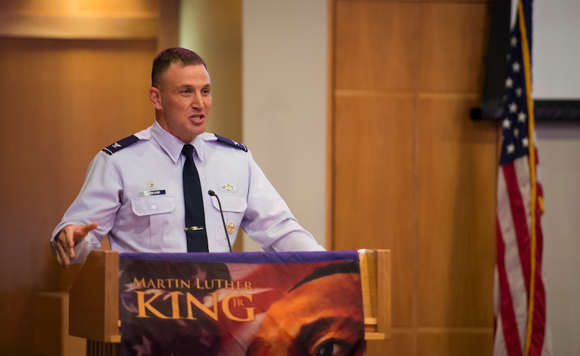 Col. John Lamontagne, 437th Airlift Wing commander, gives his opening remarks to Airmen and Sailors attending the Martin Luther King Jr. Day Celebration event Jan. 15, 2016, at the Chapel Annex on Joint Base Charleston – Air Base, S.C. JB Charleston's Multicultural Committee put up the event in celebration of King's legacy. (U.S. Air Force Photo/Senior Airman Clayton Cupit)