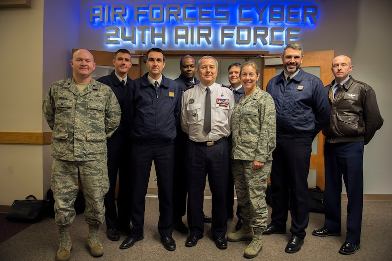 U.S. Air Force Maj. Gen. Shelia Zuehlke (center-right), mobilization assistant to the commander, 24th Air Force and Air Forces Cyber Command (AFCYBER), and French Air Force Brig. Gen. Thierry Combel (center), Deputy Director General of Employment and Training-Air Force Human Resources, stand with other members of a cybersecurity delegation during a visit to Headquarters, 24AF - AFCYBER, Joint Base San Antonio - Lackland, Texas, Jan 13. The delegation visited to discuss how the U.S. and French Air Force's approach cyber organization, training, and exercise participation as well as to facilitate future partnerships and engagements.. (U.S. Air Force photo by Master Sgt. Luke P. Thelen/Released)