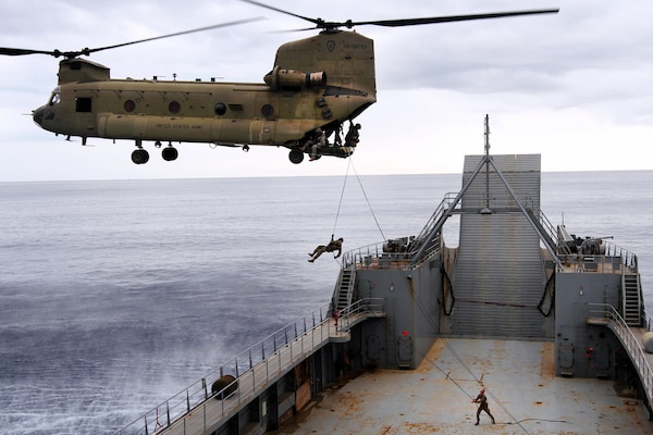 Soldiers with 25th Infantry Division conduct air assault operations onto deck of 8th Theater Sustainment Command's Logistical Support Vessel-2, off coast of Honolulu, Hawaii,