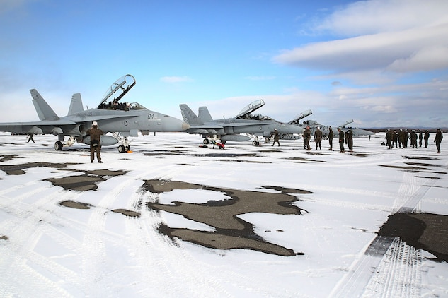 Maintainers with Marine All-Weather Fighter Attack Squadron (VMFA) 224 prepare F/A-18D Hornets to take off at Chitose Air Base in Hokkaido, Japan, Jan. 14, 2016. VMFA (AW)-224, homebased at MCAS Beaufort, S.C., is temporarily based in Iwakuni on a unit deployment program and deployed to Northern Japan to participate in the Chitose Aviation Training Relocation Exercise Jan. 12-22. During the exercise, the squadron conducted dissimilar air combat training with and against the Japan Air Self-Defense Force to further support combined interoperability and Pacific theater security cooperation.