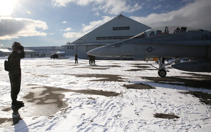 A maintainer with Marine All-Weather Fighter Attack Squadron (VMFA) 224 salutes the pilots inside an F/A-18D Hornet before taking off at Chitose Air Base in Hokkaido, Japan, Jan. 14, 2016. VMFA (AW)-224, homebased at MCAS Beaufort, S.C., is temporarily based in Iwakuni on a unit deployment program and deployed to Northern Japan to participate in the Chitose Aviation Training Relocation Exercise Jan. 12-22. During the exercise, the squadron conducted dissimilar air combat training with and against the Japan Air Self-Defense Force to further support combined interoperability and Pacific theater security cooperation.