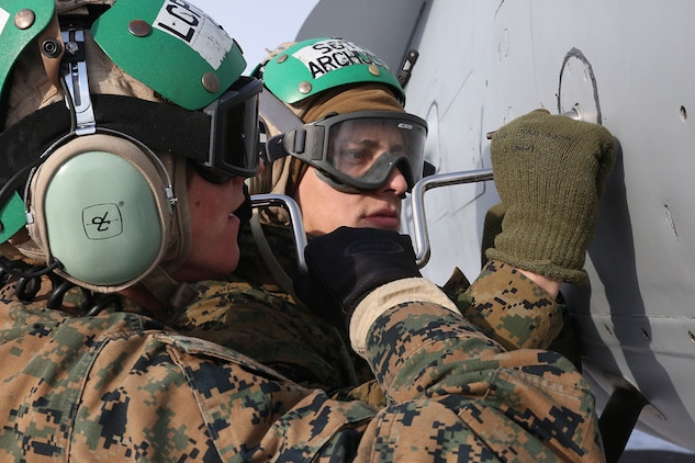 Sgt. Leonard Archuleta, an avionics collateral duty quality assurance representative, right, and Lance Cpl. Sean Stiles, an avionics technician, left, with Marine All-Weather Fighter Attack Squadron (VMFA) 224 work on an F/A-18D Hornet at Chitose Air Base in Hokkaido, Japan, Jan. 14, 2016. VMFA (AW)-224, homebased at MCAS Beaufort, S.C., is temporarily based in Iwakuni on a unit deployment program and deployed to Northern Japan to participate in the Chitose Aviation Training Relocation Exercise Jan. 12-22. During the exercise, the squadron conducted dissimilar air combat training with and against the Japan Air Self-Defense Force to further support combined interoperability and Pacific theater security cooperation.
