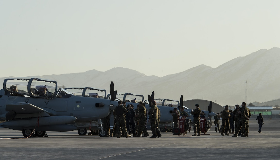 Four A-29 Super Tucanos arrive at Hamid Karzai International Airport, Afghanistan, Jan. 15, 2016. The aircraft will be added to the Afghans' inventory in the spring of 2016. The A-29 Super Tucano is a 'light air support' aircraft capable of conducting close air support, aerial escort, armed overwatch and aerial interdiction. Designed to operate in high temperature and in extremely rugged terrain, the A-29 Super Tucano is highly maneuverable 4th generation weapons system capable of delivering precision guided munitions. It can fly at low speeds and low altitudes, is easy to fly, and provides exceptionally accurate weapons delivery. It is currently in service with 10 different air forces around the world. (U.S. Air Force photo by Tech. Sgt. Nathan Lipscomb)