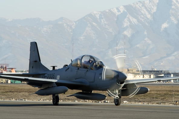 An A-29 Super Tucano taxies across the airfield at Hamid Karzai International Airport, Afghanistan, Jan. 15, 2016. The aircraft will be added to the Afghan Air Force's inventory in the spring of 2016. The A-29 is a light air support aircraft capable of conducting close air support, aerial escort, armed overwatch and aerial interdiction. (U.S. Air Force photo/Tech. Sgt. Nathan Lipscomb)