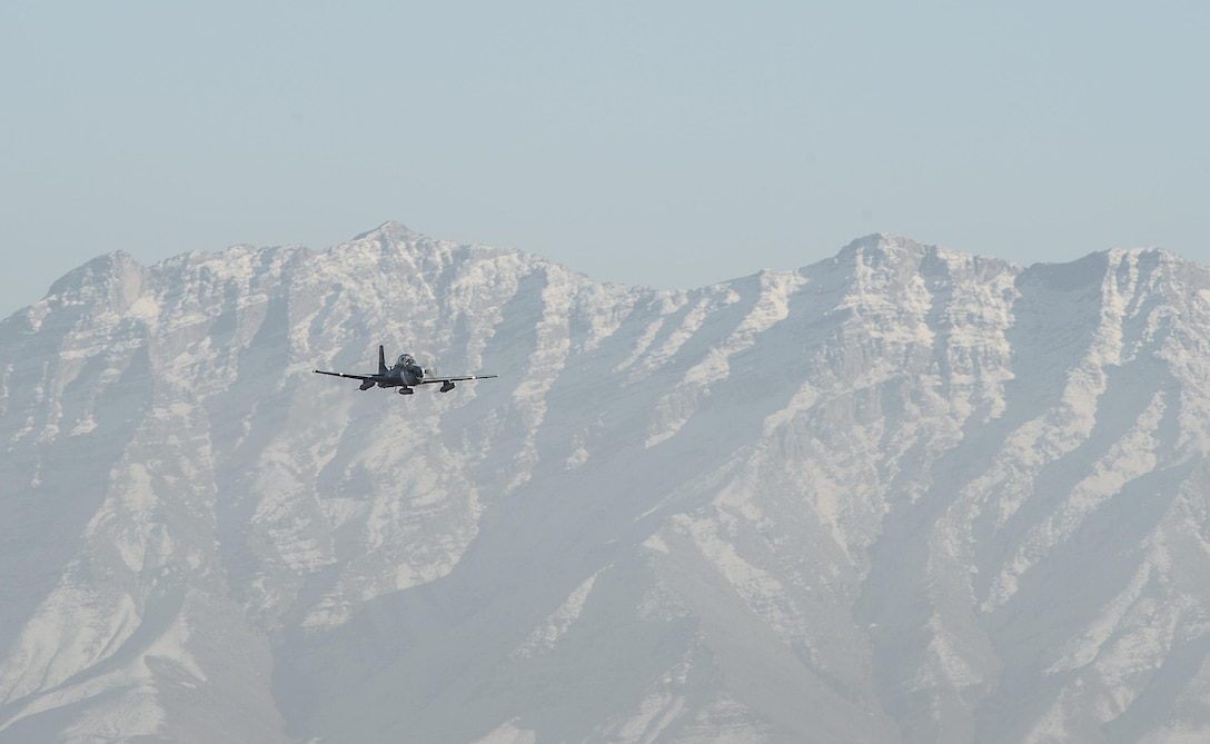 An A-29 Super Tucanos flies over Hamid Karzai International Airport, Afghanistan, Jan. 15, 2016. The aircraft will be added to the Afghans' inventory in the spring of 2016. The A-29 Super Tucano is a 'light air support' aircraft capable of conducting close air support, aerial escort, armed overwatch and aerial interdiction. Designed to operate in high temperature and in extremely rugged terrain, the A-29 Super Tucano is highly maneuverable 4th generation weapons system capable of delivering precision guided munitions. It can fly at low speeds and low altitudes, is easy to fly, and provides exceptionally accurate weapons delivery. It is currently in service with 10 different air forces around the world. (U.S. Air Force photo by Tech. Sgt. Nathan Lipscomb)