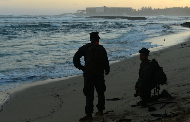 Marines report a piece of debris to the Haleiwa Incident Command Post during a beach sweep near Turtle Bay Resort in Kahuku, Hawaii, Jan. 17, 2016. The Marines are assisting the Coast Guard and other first responders with search and rescue efforts for 12 missing Marines from a helicopter crash along the North Shore of Oahu. (U.S. Coast Guard photo by Petty Officer 1st Class Levi Read/Released)