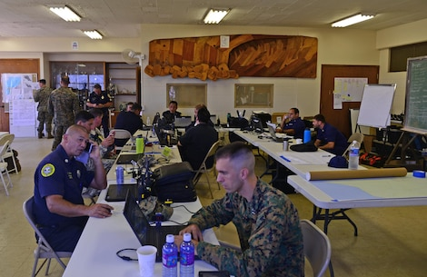 Multiple federal, state and local agencies are coordinating search and rescue efforts from the Haleiwa Incident Command Post in Haleiwa, Hawaii, Jan. 17, 2016. The search and rescue efforts are for 12 missing Marines who were involved in a helicopter crash along the North Shore of Oahu. (U.S. Coast Guard photo by Petty Officer 1st Class Levi Read/Released)