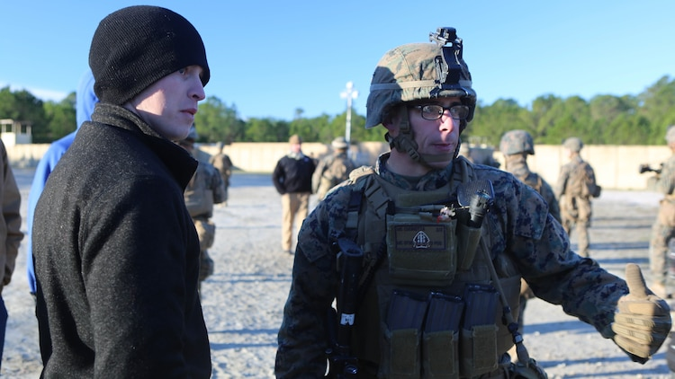 Staff Sgt. Michael Cucinotta, a platoon sergeant with 2nd Battalion, 2nd Marine Regiment, gives instructions to a refugee role player during a noncombatant evacuation training operation at Marine Corps Base Camp Lejeune, North Carolina, Jan. 14, 2016. The Marines successfully processed 28 refugee role players through a notional forward operating base. The exercise was part of the unit's training in preparation for an upcoming deployment to Okinawa, Japan.