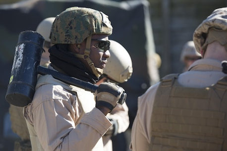 Sgt. Joseph Kharlange, an Explosive Ordinance Disposal technician with EOD Company, 8th Engineer Support Battalion, prepares for a simulated raid during a breaching course at Camp Lejeune, N.C., Jan. 14, 2016. The training is designed to incorporate different methods of entering a building, such as using a hammer to knock down the door in case the explosive fails, to prepare EOD for numerous scenarios they may encounter on a deployment. (U.S. Marine Corps photo by Lance Cpl. Samuel Guerra/Released)