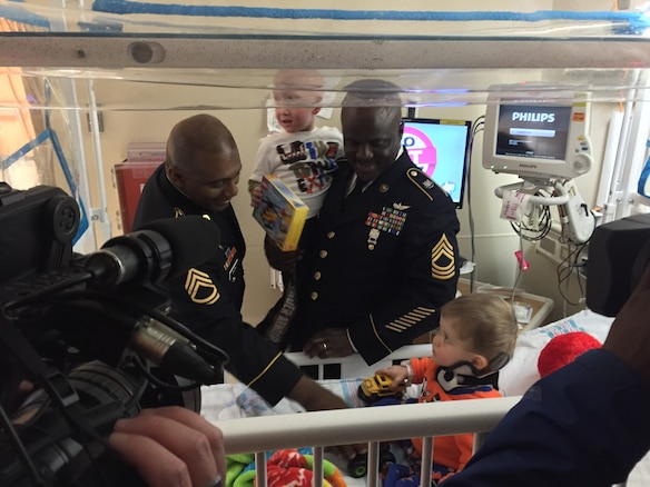 Master Sgt. Troy Roberson and Sgt. 1st Class Joseph Bush from the 11th Theater Aviation Command (TAC), volunteered their time to distribute toys to hospitalized children at Kosair Children's Hospital in Louisville, Ky., Jan. 9. The toys were donated by soldiers, family members and friend of the 11th TAC. The 11th TAC is the only aviation command in the U.S. Army Reserve. (U.S. Army photo by Capt. Matthew Roman, 11th Theater Aviation Command Public Affairs Officer)
