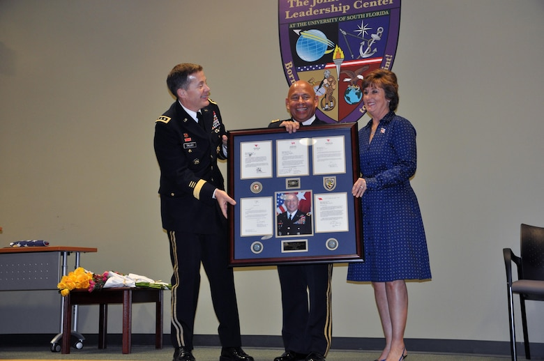 In a retirement ceremony held on Jan. 16, 2016, co-hosted by the U.S. Army Reserve and the University of South Florida, Lt. Gen. Jeffrey Talley, chief of the Army Reserve, recognized Maj. Gen. Luis Visot for his more than 37 years of service to the U.S. Army and the Nation. Maj. Gen. Visot and his wife, Dr. Cindy Visot, were both honored for their extensive time and contributions to their community, to their civilian occupations and to the Soldiers, civilians and families of the U.S. Army Reserve.