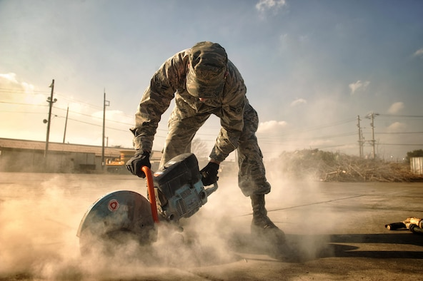 Airman 1st Class Connor Harrington, 374th Civil Engineer Squadron pavement and equipment apprentice, performs a spall repair at Yokota Air Base, Japan, Jan. 13, 2016. From keeping the flightline mission ready to maintaining the roads and sidewalks, the behind the scenes work done by the group of Airmen known as the 'Dirt Boys' keep Yokota's mission going. (U.S. Air Force photo by Airman 1st Class Delano Scott/Released)