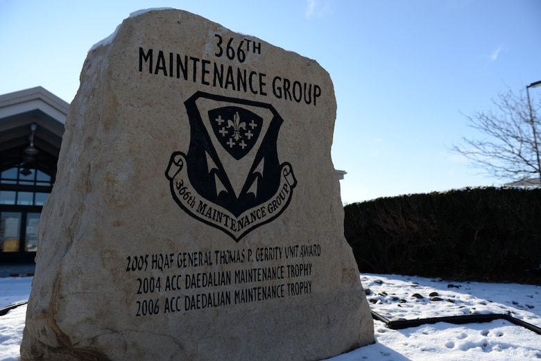 Several awards adorn an engraved stone sign outside 366th Maintenance Group Headquarters on Mountain Home Air Force Base, Idaho, on Dec. 29, 2015. A new line might be added to reflect the Clements McMullen Memorial Daedalian Weapons Systems Maintenance Trophy if the Regulators' package wins at the Air Force level. (U.S. Air Force Photo by Senior Airman Shane Mitchell/RELEASED)
