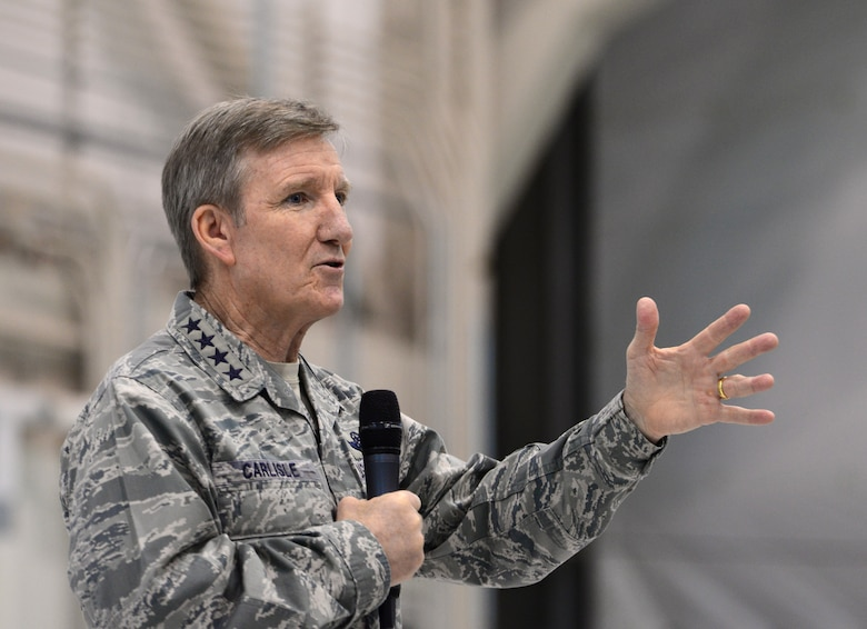 Gen. Hawk Carlisle, commander of Air Combat Command, briefs Airmen of the 432nd Wing/432nd Air Expeditionary Wing Jan. 14, 2016, during his visit to Creech Air Force Base, Nevada. During the all-call, Carlisle recapped the findings of the Culture and Process Improvement Program, an initiative which studied challenges within the remotely piloted aircraft enterprise. He also explained the measures the Air Force is taking to alleviate the problems. (U.S. Air Force photo by Senior Airman Christian Clausen/Released)