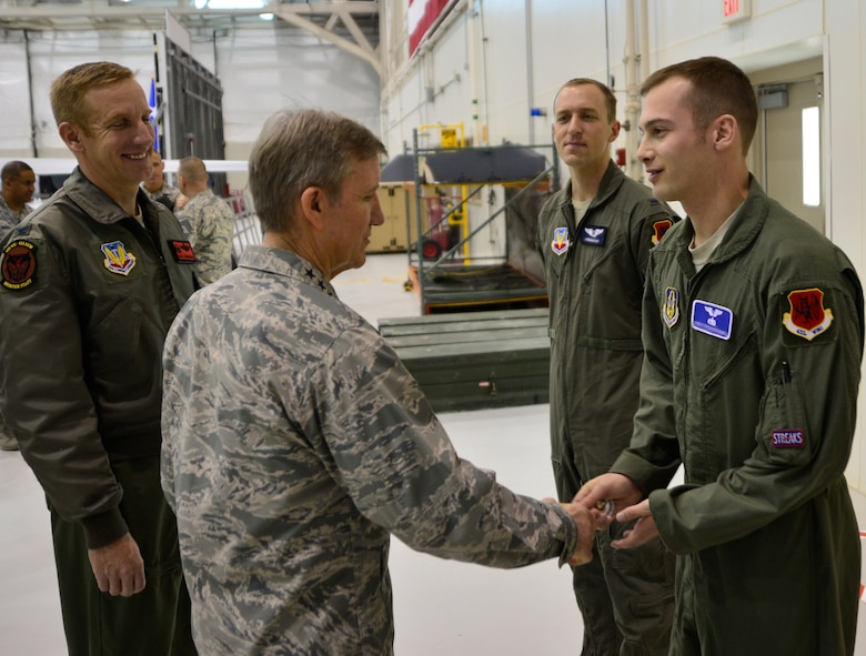 Gen. Hawk Carlisle, commander of Air Combat Command, coins Tech. Sgt. Chad, 91st Attack Squadron sensor operator Jan. 14, 2016, during his visit to Creech Air Force Base, Nevada. Carlisle coined five superior performers from around the wing for their outstanding contributions to the remotely piloted enterprise. (U.S. Air Force photo by Senior Airman Christian Clausen/Released)