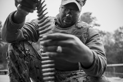 Master at Arms 2nd Class Winston Hardison counts 7.62mm rounds during weapons sustainment training Jan. 9, 2016, at Joint Base Charleston, S.C. The two day, semi-annual training event was hosted by the Coastal Riverine Squadron 10 Bravo Company, a Navy Reserve team stationed at Joint Base Charleston – Weapons Station. The participants were required to show proficiency and familiarization with the M240B machine gun. (U.S Air Force Photo/Staff Sgt. Jared Trimarchi)