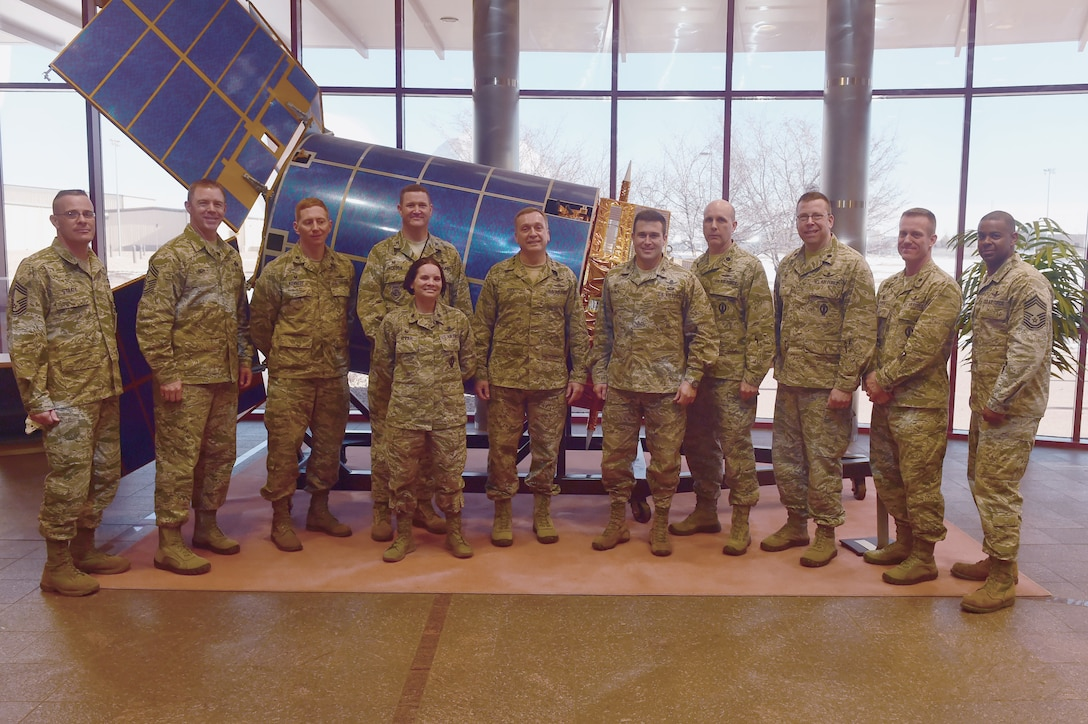 Lt. Gen. David J. Buck, Commander, 14th Air Force (Air Forces Strategic), Air Force Space Command; and Commander, Joint Functional Component Command for Space, U.S. Strategic Command, and other members of AF Space Command pose with 460th Space Wing leadership base Jan. 14, 2016, at Buckley Air Force Base, Colo. Buck visited base facilities and met with members of Team Buckley to discuss the 460th Space Wing mission. (U.S. Air Force photo by Airman 1st Class Luke W. Nowakowski/Released))