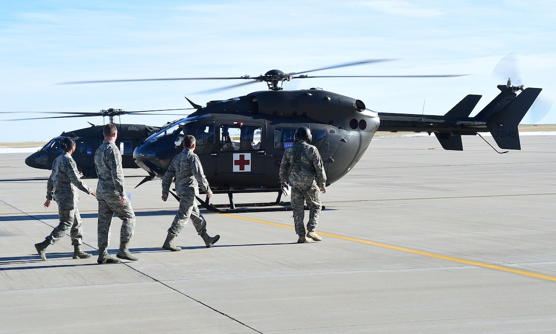 Lt. Gen. David J. Buck, Commander, 14th Air Force (Air Forces Strategic), Air Force Space Command; and Commander, Joint Functional Component Command for Space, U.S. Strategic Command, walks to a helicopter at the Army Aviation Support Facility Jan. 14, 2016, at Buckley Air Force Base, Colo. Buck visited base facilities and met with members of Team Buckley to discuss the 460th Space Wing mission. (U.S. Air Force photo by Airman 1st Class Gabrielle Spradling)