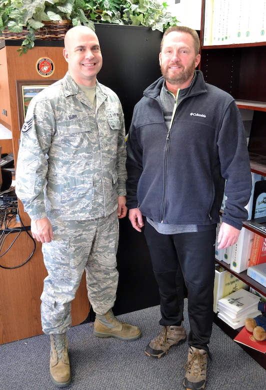 Staff Sgt. Scott Burr, left, safety and occupational health monitor with the 111th Attack Wing at the Horsham Air Guard Station, Pennsylvania meets with retired 111th ATKW Lt. Col. Scott Hreso on Jan. 6, 2016 here. Hreso, a former A-10 Thunderbolt II pilot and chief of safety, revisits his old office and celebrates his first full year of military retirement this week. (U.S. Air National Guard photo by Master Sgt. Christopher Botzum)