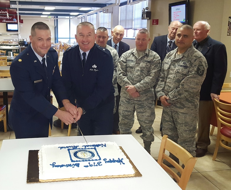 Major Jeremiah Buckenberger, 143d Civil Engineering Squadron Commander and Brigadier General Matthew Dzialo ceremonially cut the cake celebrating the 379th Birthday of the National Guard during a ceremony at Quonset Air National Guard Base, North Kingstown, Rhode Island on December 5, 2015. Photo by Master Sgt Janeen Miller