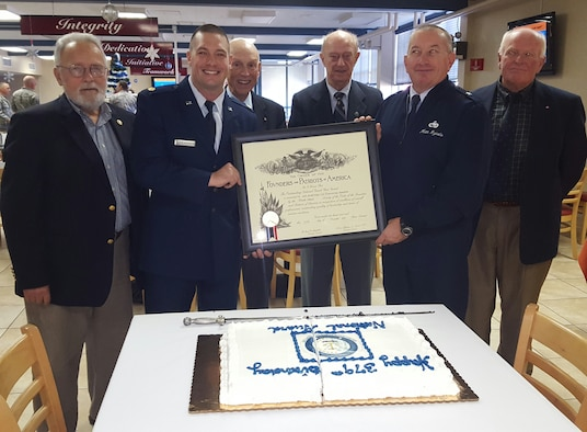 Major Jeremiah Buckenberger, 143d Civil Engineering Squadron Commander and Brigadier General Matthew Dzialo with members of the Rhode Island Society of the Founders and Patriots hold the 2015 Founders and Patriots award which was presented to the 143 CES during a ceremony at Quonset Air National Guard Base, North Kingstown, Rhode Island on December 5, 2015. Photo by Master Sgt Janeen Miller
