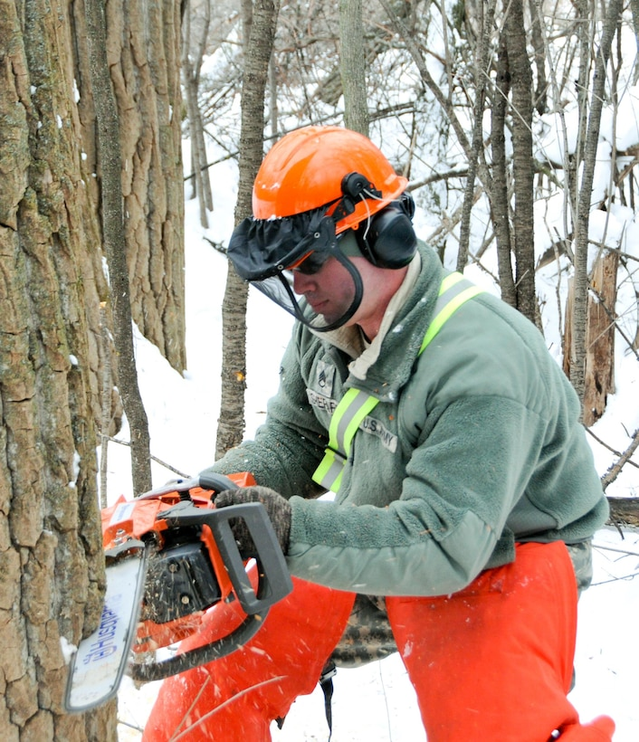 Soldiers with the 770th Engineer Company, 479th Engineer Battalion, 411th Engineer Brigade, 412th Theater Engineer Command, are working to clear land in Mattydale, N.Y., which will become home to a new Army Reserve Center.