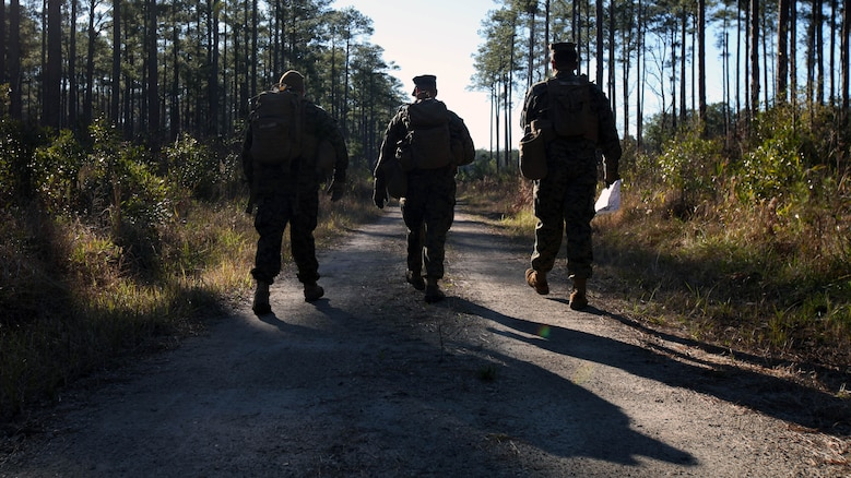 Marines with Marine Wing Support Squadron 274's Engineer Company, Heavy Equipment Platoon head back to the starting point after completing a land navigation course at Marine Corps Air Station Cherry Point, N.C., Jan. 13, 2016. During the 19-point course, 20 Marines headed to the field to re-experience the basic land navigation process. The course was a refresher for most of the Marines, who have not used land navigation since Marine Combat Training.
