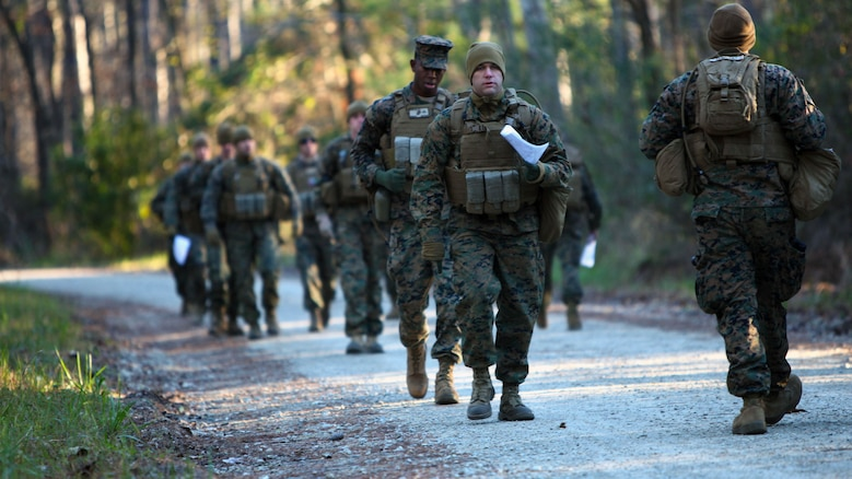 Marines with Marine Wing Support Squadron 274's Engineer Company, Heavy Equipment Platoon set their pace count before beginning a land navigation course at Marine Corps Air Station Cherry Point, N.C., Jan. 13, 2016. During the 19-point course, 20 Marines headed to the field to re-experience the basic land navigation process. The course was a refresher for most of the Marines, who have not used land navigation since Marine Combat Training.
