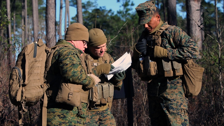 Marines with Marine Wing Support Squadron 274's Engineer Company, Heavy Equipment Platoon review their map during a land navigation course at Marine Corps Air Station Cherry Point, N.C., Jan. 13, 2016. During the 19-point course, 20 Marines headed to the field to re-experience the basic land navigation process. The course was a refresher for most of the Marines, who have not used land navigation since Marine Combat Training.