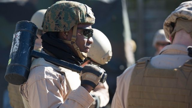 Sgt. Joseph Kharlange, an Explosive Ordinance Disposal technician with EOD Company, 8th Engineer Support Battalion, prepares for a simulated raid during a breaching course at Camp Lejeune, N.C., Jan. 14, 2016. The training is designed to incorporate different methods of entering a building, such as using a hammer to knock down the door in case the explosive fails, to prepare EOD for numerous scenarios they may encounter on a deployment.