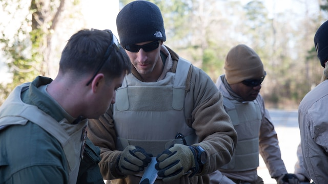 Explosive Ordinance Disposal technicians with EOD Company, 8th Engineer Support Battalion, wrap tape around detonation cord during a breaching course at Camp Lejeune, N.C., Jan. 14, 2016. Marines participate in this course every six months to be certified breachers.