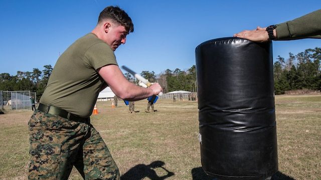 "Lance Cpl. Hunter Rooks, a Marine with Combat Logistics Battalion 22, swings at a stationary target after being sprayed in the eyes with oleoresin capsicum, more commonly known as OC spray, at Camp Lejeune, N.C., Jan. 14. ""I feel this was an effective means of instruction because if you or any of your Marines accidentally come in contact with the spray you're going to know what to expect,"" said Jolly."