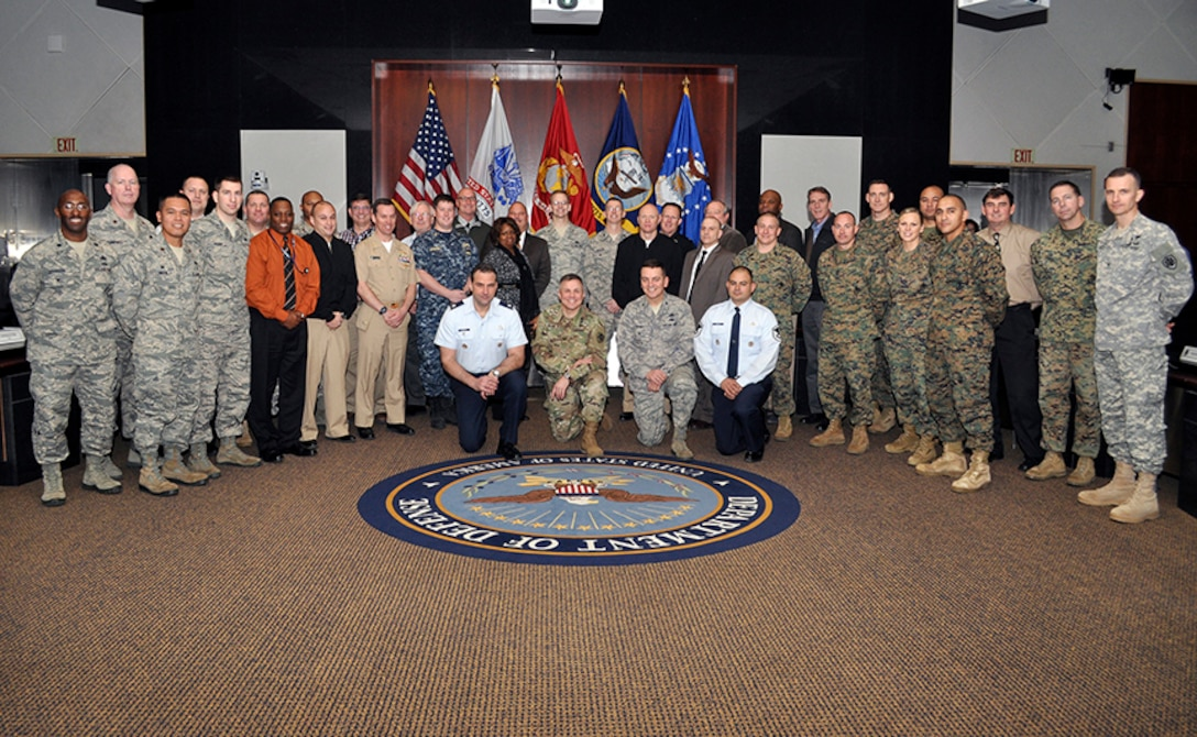 Air Force Brig. Gen. Mark McLeod, Defense Logistics Agency Energy commander, poses for a group photo with attendees of the 15th annual Joint Petroleum Seminar at the McNamara Headquarters Complex at Fort Belvoir, Virginia, Jan. 13.