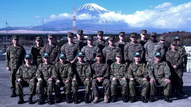 Marines pose for a picture with members of the Japan Ground Self-Defense Force during a tour of JGSDF facilities Jan. 13 at Camp Komakado, Shizuoka, Japan. The visit strengthened the relationship between Marines and members of the JGSDF by allowing the service members to discuss training and tactical procedures and observe each other's tactical equipment and resources. The Marines visited the JGSDF motor pool, Improved Moving Target Simulator and 1st Anti-Aircraft Battalion building. The Marines are from 2nd Low Altitude Air Defense Battalion, Marine Aircraft Control Group 28; currently assigned to the 31st Marine Expeditionary Unit, III Marine Expeditionary Force under the unit deployment program.