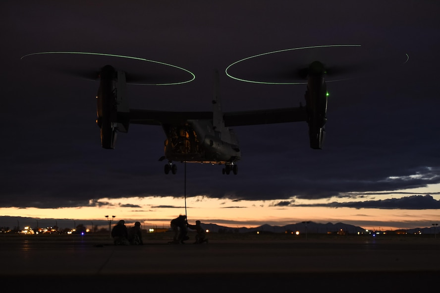 Soldiers with the 19th Special Operations Group practice fast-roping out of a CV-22 Osprey in preparation for a routine training operation at Hill Air Force Base, Utah, Nov. 4, 2015. Ultimate Archer was a task force exercise that put Air Commandos in an unfamiliar environment to practice deployed operations. The six-day exercise gave Hurlburt Airmen a chance to work with units outside of the 1st Special Operations Wing including the 388th Fighter Wing and the 19th SOG. (U.S. Air Force photo by Airman Kai White)