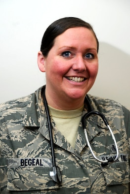 Staff Sgt. Christina Begeal, a 22nd Medical Group aerospace medical technician, poses for a photo, Jan. 13, 2016, at McConnell Air Force Base, Kan. Begeal saved the life of an individual at a local restaurant who suffered a seizure during his work shift. (U.S. Air Force photo/Airman Jenna K. Caldwell)