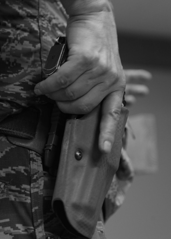 Air Force commanders can take additional measures to secure personnel and property on their installations through the Unit Marshal and Security Forces Staff Arming programs along with the Law Enforcement Officer Safety Act allow service members to carry weapons. (U.S. Air Force courtesy photo)
