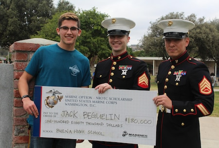 Sergeant Weldon Housley, center, and Staff Sergeant Edwin Salvatierra, right, present a Naval Reserve Officers Training Corps scholarship check to Jack Beguelin at Buena High School in Ventura, Calif., Jan. 15, 2016. The NROTC scholarship, valued at up to $180,000, will pay for the cost of full tuition, books and other educational fees at many of the country's leading colleges and universities. (U.S. Marine Corps photo by Staff Sgt. Alicia R. Leaders/Released)