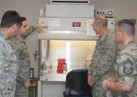 Lt. Col. Ethiel Rodriquez, Diagnostics and Therapeutics Squadron Laboratory Flight Commander and laboratory technician SSgt. John Reeves brief the Air Force Surgeon General, Lt. Gen. Mark Ediger and the Chief, Medical Enlisted Force, CMSgt. Jason Pace during their visit to the Wright-Patterson Medical Center on Jan. 13, 2015.